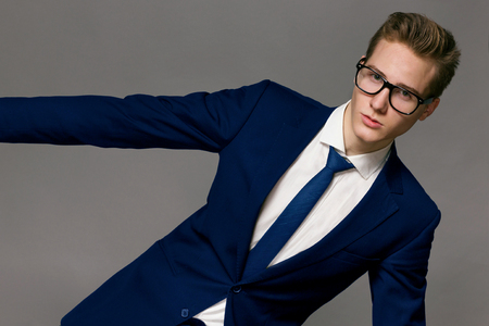 only young adults: Male Model wearing a jacket and glasses Stock Photo