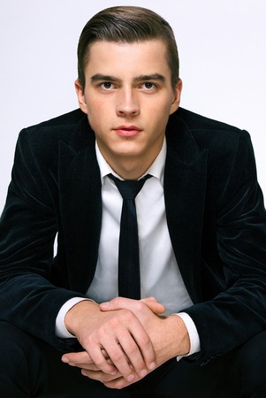 american sexy: model handsome young guy in a business suit and tie