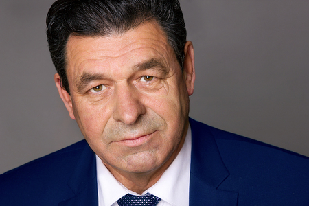 aged: Portrait of a middle-aged man in a blue suit Stock Photo