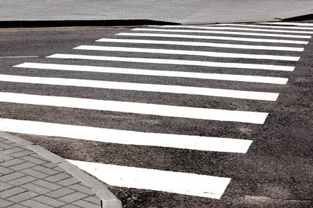 strips away: Road marking transition white on asphalt Stock Photo