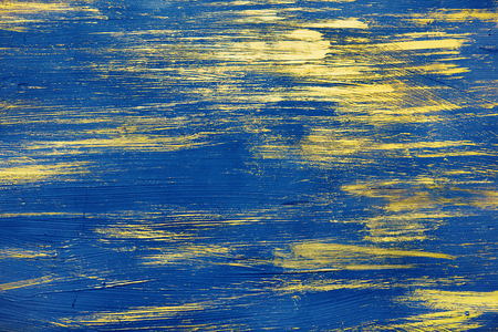 The smears of blue and gold paint are randomly scattered over the background