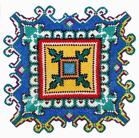 cross-stitch multi-colored ornament on a white background in isolation