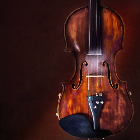 Violin musical instrument orchestra close-up isolated on dark brown background