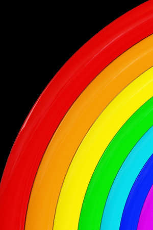 A rainbow of seven colors on a black background