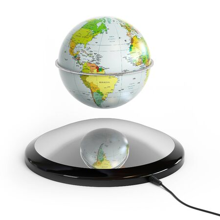 Globe with a magnetic stand, hovering in the air Stock Photo