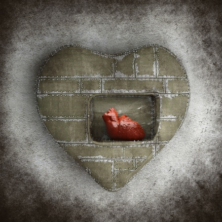 The human heart inside another heart in vintage style with dirt and rubs