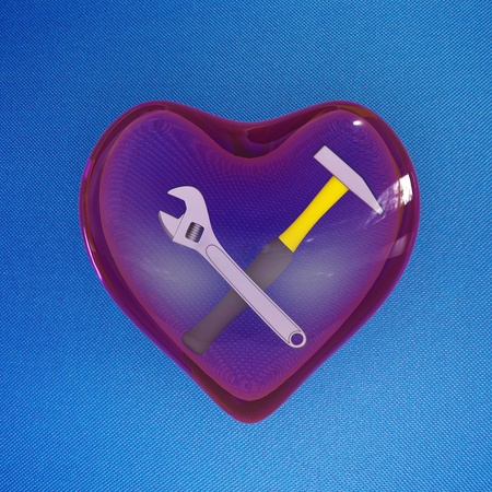 Instruments (wrench and hammer) inside a glass heart
