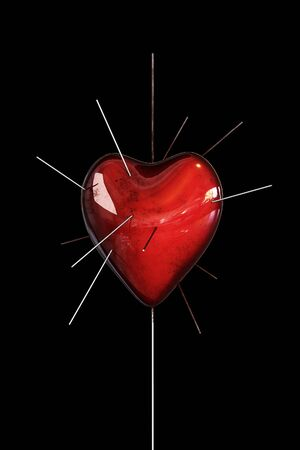 Heart, punctured spokes isolated on black background in the blood