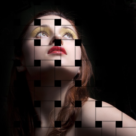 Portrait of a young woman, isolated on a black background with the effect of interlacing photo