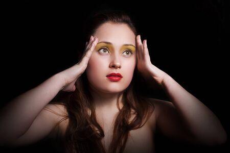 Thoughtful beautiful woman with bright makeup Stock Photo
