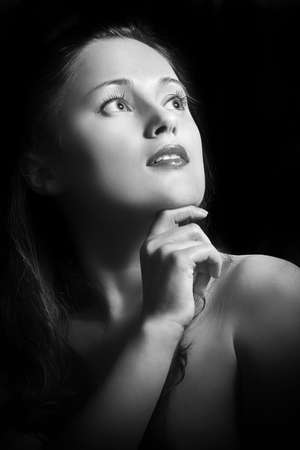 Black and white portrait a beautiful girl isolated on black background Stock Photo