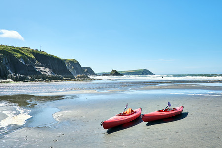 Canoes on Newport Sands, Newport Bay, Pembrokeshire, Dyfed, Wales, UK
