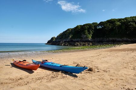 Two canoes on the beach, Barafundle Beach, Bay near Stackpole, Pembrokeshire, Wales, UK
