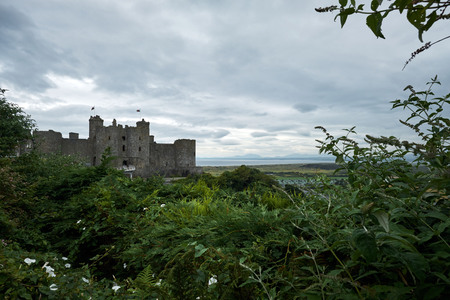 The towers of Harlech Castle, North Wales, in a cloudy day,