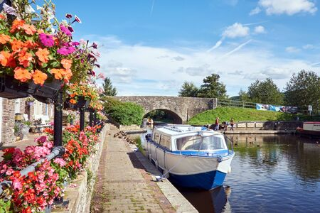 A boat on Brecon canal basin Powys Wales UK