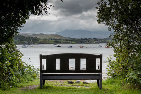 peaty: Wood bench in front of the sea, Isle of Skye, Scotland