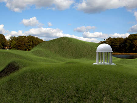 white temple in green grass photo