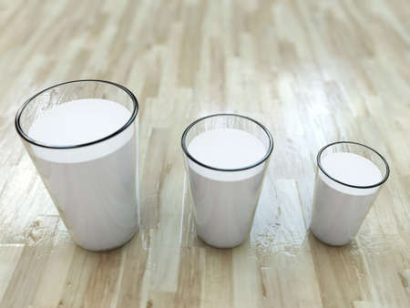 milk glasses on wooden floor photo