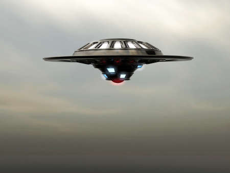 saucer: ufo spaceship vessel flying in cloudy sky Stock Photo