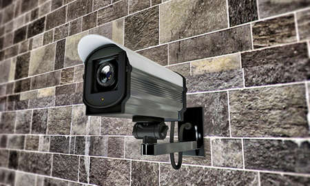 cctv security: security camera on tiled wall Stock Photo