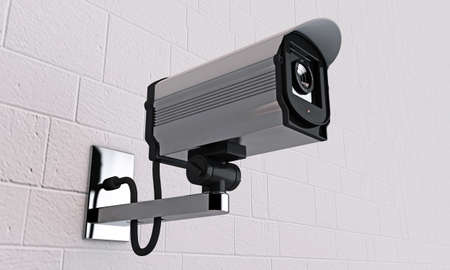 security camera on tiled wall photo