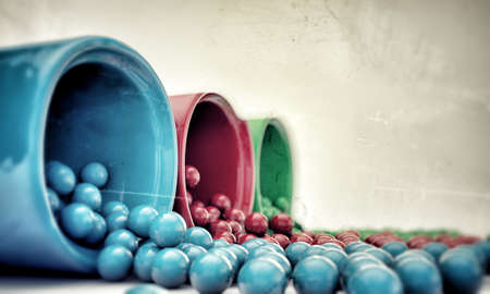 gumballs coming out from dispensers Stock Photo - 14319654