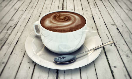 talian: hot cappuccino in white ceramic cup on wooden white table
