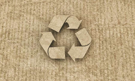 recycle symbol on cardboard photo