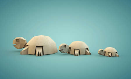 ingenious: tortoises origami made with cardboard paper isolated on blue background