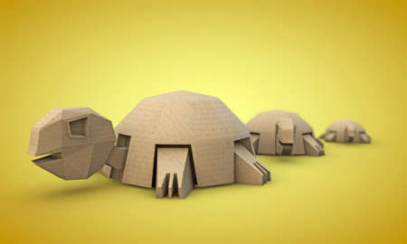 ingenious: tortoises origami made with cardboard paper isolated on yellow background