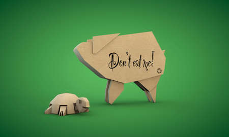 cardboard shaped like a pig and tortoise isolated on green background photo