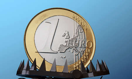 euro coin in a bear trap isolated on blue background photo