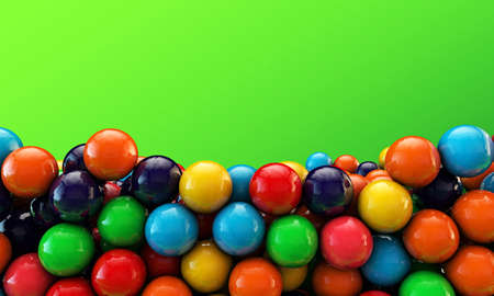 many gumballs isolated on green background