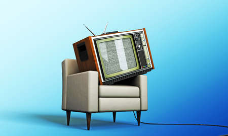 old tv relaxing in a white armchair isolated on blue background photo