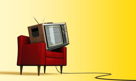 old tv relaxing in a red armchair isolated on yellow background photo