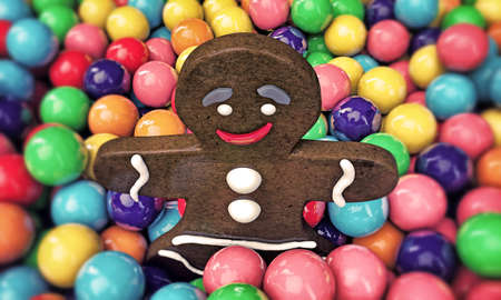 gumballs: christmas gingerbread man playing with many gumballs  Stock Photo