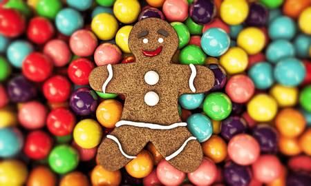 christmas gingerbread man sleeping on gum balls bed Standard-Bild