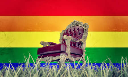 regal armchair with  pride flag on background photo