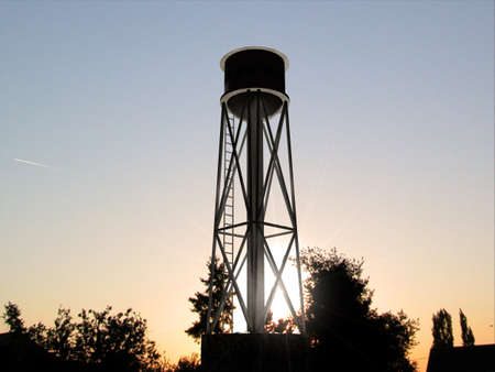 water tank: old water tank silhouette at sunset