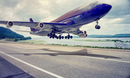 airplane landing on a highway Stock fotó