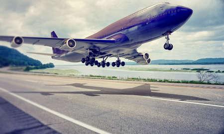 airplane landing on a highway Standard-Bild