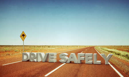 drive safely: drive safely sign in a desert road