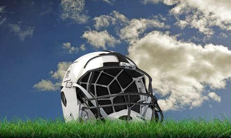 nfl helmet: NFL helmet isolated on green grass