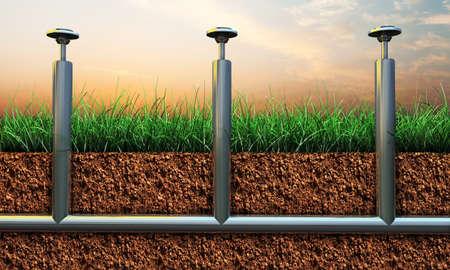 sprinkler: illustration of sprinkler pipes on soil section  Stock Photo