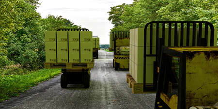 forklifts: forklifts moving on a country road Stock Photo