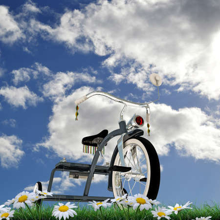 metalized: blue tricycle on green grass Stock Photo
