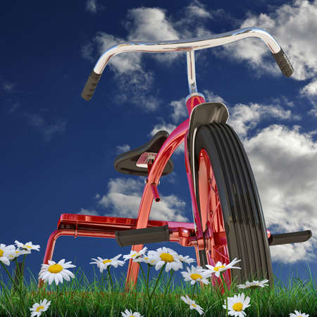 metalized: red tricycle on green grass