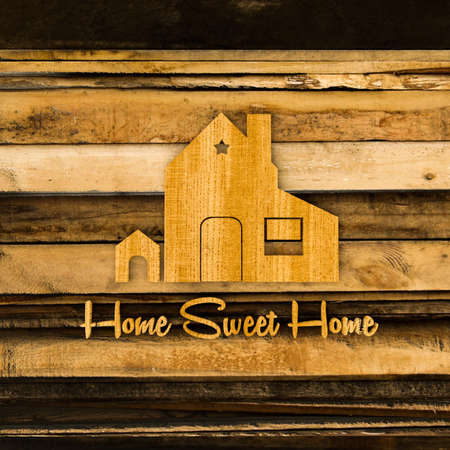 home decoration: home silhouette sign on wooden planks Stock Photo