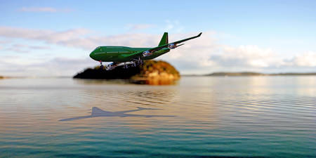 airplane landing: tourism airplane landing close the ocean Stock Photo