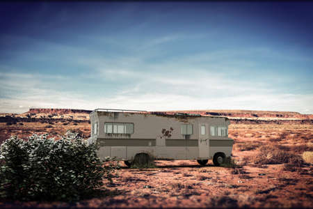 desolation: old rusty camper in New Mexico desert Stock Photo